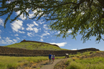 Visitors walk the trail by Puakohola Heiau site, South Kohala, Big Island, Hawaii