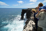 Visitors view Holei Sea Arch, chain of craters road, Hawaii Volcanos National Park