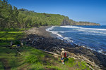 Hikers enjoy Pololu Valley Black Sand Beach, Big Island, Hawaii