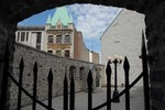 View through wrought-iron gate of courtyard and buildings, Quebec City, Canada.
