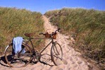 J5-Bicycle on sand dunes overlooking ocean, Salisbury, MA104162