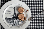 Eiffel tower plate w/ tiny cakes and fork.