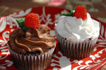 Dark chocolate resapberry-filled cupcakes with chocolate and vanilla frosting, raspberry candies.