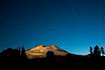 Mt. Baker lit by a setting full moon just before dawn with the Big Dipper, North Star, and other stars shining above, viewed from the Railroad Grade Trail, Mt. Baker-Snoqualmie National Forest, Washington, USA, September, 2008_WA_5102