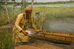 Exhibit showing woman with birchbark canoe and basket in a lakeside setting in the Ziibiwing Center of Anishinabe Culture & Lifeways, Mt. Pleasant, Lower Peninsula, Michigan, USA, 2008_MI_6671