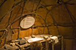 Teaching Lodge exhibit showing birchbark wigwam interior with stone tools in the Ziibiwing Center of Anishinabe Culture & Lifeways, Mt. Pleasant, Lower Peninsula, Michigan, USA, 2008_MI_6685