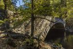 Pohono Bridge over the Merced River  in autumn in Yosemite Valley, Yosemite National Park, California, USA