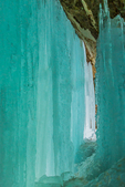 The lovely aquamarine color of ice curtains in the Sand Point area of Pictured Rocks National Lakeshore in the Upper Peninsula of Michigan, USA