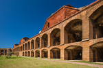 The brick-faced architecture of Fort Jefferson with its rows of casemates for all the cannons planned for the fort, viewed from the parade ground, on Garden Key in Dry Tortugas National Park, Florida, USA