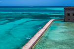 Moat wall around Fort Jefferson with the aquamarine waters of the Gulf of Mexico, Garden Key in Dry Tortugas National Park, Florida, USA