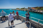 Park visitors leaving Fort Jefferson on the ferry, Yankee Freedom III, Dry Tortugas National Park, Florida, USA