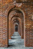 The elegant arched brick architecture of Fort Jefferson, a 19th century fortress on Garden Key in Dry Tortugas National Park, Florida, USA