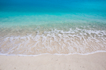 Beautiful shell sand beach with turquoise waters just outside Fort Jefferson on Garden Key in Dry Tortugas National Park, Florida, USA