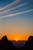 Sunset with a series of linear clouds viewed from Chisos Basin in the Chisos Mountains of Big Bend National Park, Texas, USA