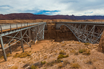 Navajo Bridge spanning the Colorado River and Marble Canyon, with the Historic Bridge (L) and the Modern Bridge ® at the edge of the Navajo Nation, adjacent to Glen Canyon National Recreation Area, Arizona, USA