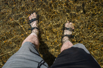 Self-Portrait of legs while Wading in Merced River at Sentinel Beach in Yosemite Valley, Yosemite National Park, California, USA