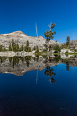 Quiet morning at Ropi Lake in the Desolation Wilderness, with Pyramid Peak in the distance, Eldorado National Forest, Sierra Nevada, California, USA