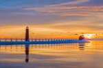 Grand Haven Lighthouse during a vivid sunset, at the mouth of the Grand River where it enters Lake Michigan, Grand Haven, Michigan, USA