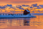 Grand Haven Lighthouse during a vivid sunset, at the mouth of the Grand River where it enters Lake Michigan, Grand Haven, Michigan, USA [No model releases; available for editorial licensing only]