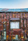 Rusted metal siding on a building from long ago in the old silver mining semi ghost town of Belmont, Nevada, USA [No property release; available for editorial licensing only]