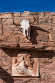 Entrance to Hubbell Trading Post with bleached cow skull and a relief sculpture of Ya Ahtsa by Philip Ayer Sawyer, Hubbell Trading Post National Historic Site within the Navajo Nation, Arizona, USA