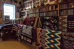 Navajo rugs for sale in the trading post, Hubbell Trading Post National Historic Site within the Navajo Nation, Arizona, USA [No property releases on the privately created and owned Navajo rugs; available for editorial licensing only]