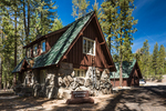 Discovery Center, an historic building made of lava rock and timber by the Civilian Conservation Corps in the 1930s, viewed along the Lily Pond Nature Trail in the Manzanita Lake area of Lassen Volcanic National Park, California, USA