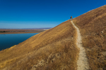 Hiker along the route to White Bluffs in Hanford Reach National Monument, Columbia River Basin, Washington State, USA