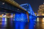 Blue Bridge at night, reflecting off the Grand River in Grand Rapids, Michigan, USA