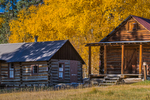 Autumn aspen color with historic ranch buildings Valles Grande within Valles Caldera National Preserve, a preserve run by the National Park Service, New Mexico, USA
