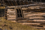 Cabins decaying into the earth in an old movie set in Valles Caldera National Preserve, a preserve run by the National Park Service, New Mexico, USA
