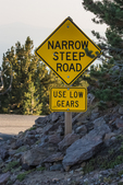 Narrow, steep road sign on the road up Paulina Peak in Newberry National Volcanic Monument, central Oregon, USA