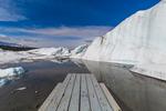 Picnic Table with melting water gathered into a glacial lake near the end of Matanuska Glacier, northeast of Anchorage, Alaska, USA