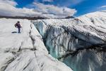 Karen Rentz with a crevasse on Matanuska Glacier, northeast of Anchorage, Alaska, USA