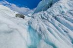 Glacial Stream of meltwaters and a glacial erratic on Matanuska Glacier, northeast of Anchorage, Alaska, USA