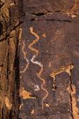Petroglyph showing snake on the sandstone walls of Nine Mile Canyon, Utah, USA