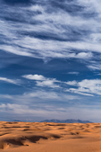 Sand dunes and a vast sky viewed from along the road to Horseshoe Canyon and The Maze in Canyonlands National Park, Utah, USA