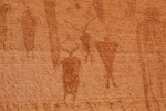 Alcove Panel of Barrier Canyon Style pictographs, painted and decorated figures 900 to 4,000+ years old,, of unknown spiritual meaning, in Horseshoe Canyon of Canyonlands National Park, Utah, USA