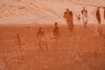 Alcove Panel of Barrier Canyon Style pictographs, painted and decorated figures 900 to 4,000+ years old,, of unknown spiritual meaning, with 20th century inscriptions or vandalism, in Horseshoe Canyon of Canyonlands National Park, Utah, USA