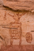 Detail of Alcove Panel of Barrier Canyon Style pictographs, painted and decorated figures 900 to 4,000+ years old,, with delicate interior lines, of unknown spiritual meaning, in Horseshoe Canyon of Canyonlands National Park, Utah, USA