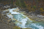 Tokumm Creek, colored blue-green with glacial flour, flows out of Marble Canyon, Kootenay National Park, British Columbia, Canada, October, 2008_CN_6076
