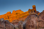 Sunset glow on sandstone formations, viewed from Camp SC3 within Salt Creek Canyon in The Needles District of Canyonlands National Park, Utah, USA