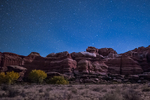 Moonlight illuminating the rock formations viewed from campsite within Salt Creek Canyon in The Needles District of Canyonlands National Park, Utah, USA