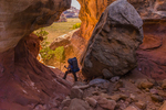 Backpacking route through a crack in a fin within Salt Creek Canyon in The Needles District of Canyonlands National Park, Utah, USA