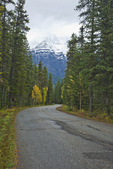Curving road with the lower flanks of snowy Mount Robson towering above, Mount Robson Provincial Park in the Canadian Rockies, British Columbia, Canada, September, 2008_CN_5174