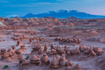 Goblins or hoodoos eroded from Entrada Sandstone in Goblin Valley State Park, with the Henry Mountains distant, photographed at twilight,  Utah, USA