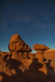 Moonlight illuminating the goblins or hoodoos eroded from Entrada Sandstone in Goblin Valley State Park, Utah, USA
