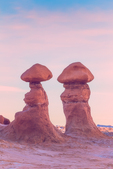 Goblins or hoodoos eroded from Entrada Sandstone, photographed in morning light, in Goblin Valley State Park, Utah, USA
