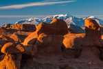 Goblins or hoodoos eroded from Entrada Sandstone, photographed in morning light, in Goblin Valley State Park, with the Henry Mountains in the distance, Utah, USA, Utah, USA