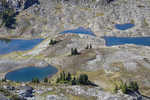 High view of the tarns and a campsite in the basin below Yellow Aster Butte, Mt. Baker Wilderness, Mt. Baker - Snoqualmie National Forest, North Cascade Range, Washington, USA, September